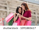 two happy young asian woman... | Shutterstock . vector #1091883617