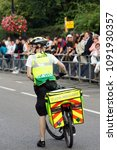 Small photo of LONDON - AUG 28 : St John Ambulance aiders, bicycles allow to move more quickly through crowds with medical equipment, are ready to help patients at Notting Hill Carnival on Aug 28, 2006, London, UK.