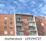 Modern apartments building at blue sky - stock photo