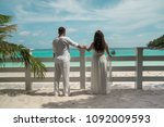 attractive young couple on the... | Shutterstock . vector #1092009593