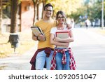 young student couple standing... | Shutterstock . vector #1092051047