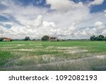 some houses and a school can be ... | Shutterstock . vector #1092082193