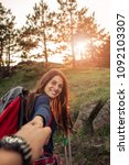 shot of a young woman hiking in ... | Shutterstock . vector #1092103307