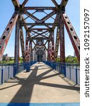 Small photo of Selective focus image of old bridge on river in arkansas usa.