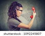 portrait of a young angry woman ... | Shutterstock . vector #1092245807