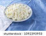 cottage cheese on a white blue... | Shutterstock . vector #1092393953