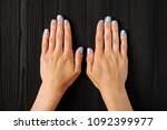 the manicure  blue with silver... | Shutterstock . vector #1092399977