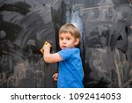 beautiful boy drawing on a... | Shutterstock . vector #1092414053