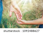 beautiful hands outdoors in a... | Shutterstock . vector #1092488627