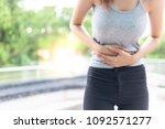 beautiful woman gets stomach... | Shutterstock . vector #1092571277