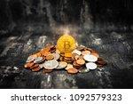 golden bitcoin and mound of...   Shutterstock . vector #1092579323