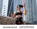 sport woman with vr glasses at... | Shutterstock . vector #1092595403