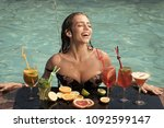 woman with alcoholic beverage... | Shutterstock . vector #1092599147