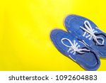 Small photo of Blue shoe with yellow background texture, summer minimal therm.