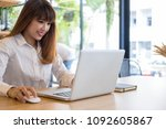 young businesswoman working... | Shutterstock . vector #1092605867