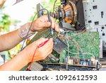 technician using voltage meter... | Shutterstock . vector #1092612593
