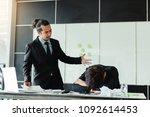 manager reprimanding an... | Shutterstock . vector #1092614453