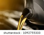 pouring oil lubricant motor car ...