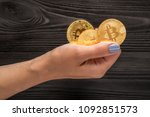 gold bitcoin in hands at the... | Shutterstock . vector #1092851573