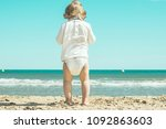 little girl in diapers on the... | Shutterstock . vector #1092863603