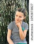 little girl deliberates...   Shutterstock . vector #1092873827