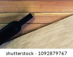 black bottle of red wine on a... | Shutterstock . vector #1092879767