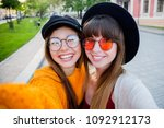 two cheerful  sisters making... | Shutterstock . vector #1092912173
