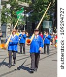 Small photo of ZURICH - AUGUST 1: Swiss National Day parade on August 1, 2009 in Zurich, Switzerland. Representative of canton Schwyz in a historical costume with traditional instrument Alphorn.