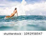beautiful fit young surfer girl ... | Shutterstock . vector #1092958547