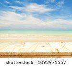 wooden floor and sea landscape... | Shutterstock . vector #1092975557