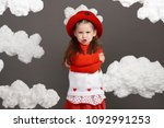 girl playing with clouds ... | Shutterstock . vector #1092991253