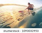 surfer rides the wave in... | Shutterstock . vector #1093032953