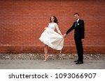 gorgeous happy wedding couple... | Shutterstock . vector #1093066907