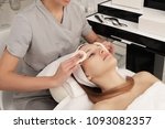 facial treatment of a young... | Shutterstock . vector #1093082357