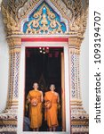 Small photo of 2018.5.5 Bangkok, Thailand : 2 Asian men were attending a monkhood ordain ceremony to become monks. There were standing at the entrance of the church at Bumpen Nue Temple