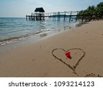 red flower and a heart sign on... | Shutterstock . vector #1093214123