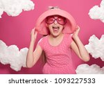 fashionable girl posing on a... | Shutterstock . vector #1093227533