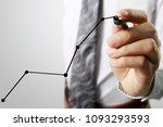businessman drawing graphics a... | Shutterstock . vector #1093293593