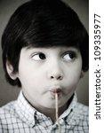kid eating spaghetti | Shutterstock . vector #109335977
