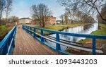 a blue wooden bridge across the ...   Shutterstock . vector #1093443203