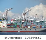KAOHSIUNG, TAIWAN - JULY 1: View of Kaohsiung's container port on July 1, 2012 in Kaohsiung. COSCO Corporation announces an increase of its shipping business by 2.8 percent in the current quarter. - stock photo