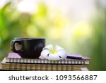 black coffee cup with flower... | Shutterstock . vector #1093566887