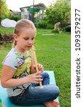 portrait of little girl playing ...   Shutterstock . vector #1093579277