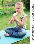 portrait of little girl playing ...   Shutterstock . vector #1093579283