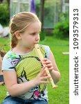 portrait of little girl playing ...   Shutterstock . vector #1093579313