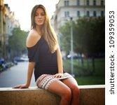 beautiful girl sitting in an... | Shutterstock . vector #109359053
