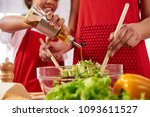 close up. small daughter pours... | Shutterstock . vector #1093611527