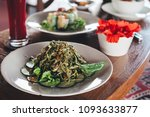 fresh green zucchini noodle... | Shutterstock . vector #1093633877