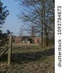 Small photo of A ruined, ruined house at the edge of the forest. Rural area, neglected buildings, Polish countryside.