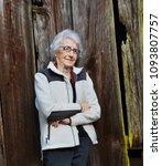 elderly woman leans against an...   Shutterstock . vector #1093807757
